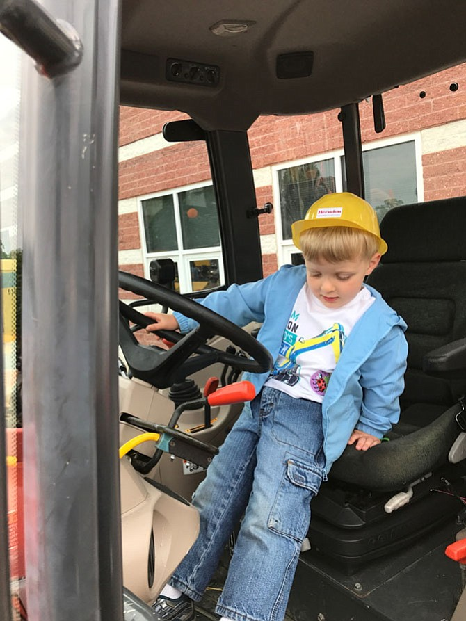 Until he can reach the pedals a little bit better, Scott Anderson, 3, may have to wait a few more years before he joins the ranks of the skilled men and women of Herndon's Department of Public Works.