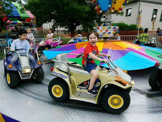 Grayson McHale of Vienna, 3-1/2, enjoyed Saturday at ViVa! Vienna! For many families, day 1 is the best day to go ... no vendors, just rides and food, keeping down the crowds.