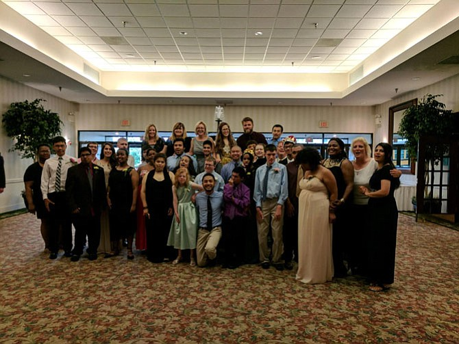 A group of students from Lee High School gather for a photo at the Day Prom.