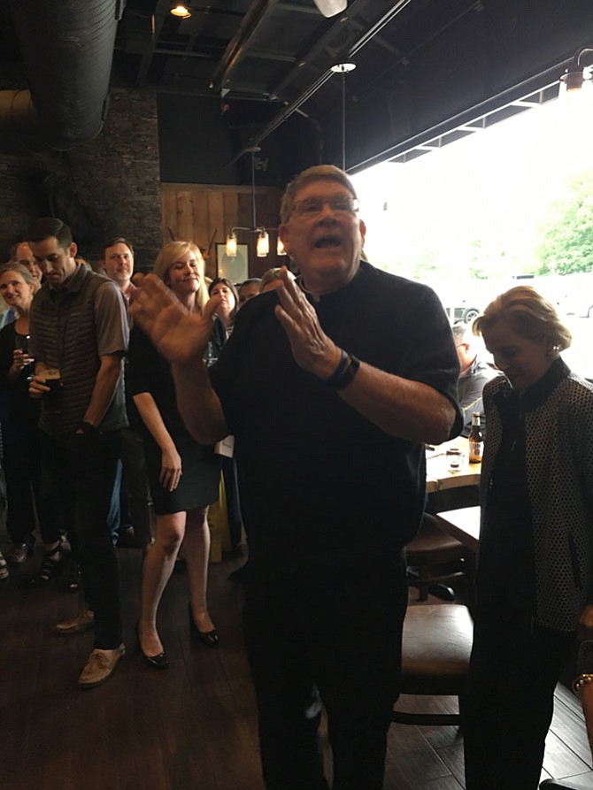 Monsignor John Enzler receives birthday wishes at a fundraiser for Life Connection Mission at Lahinch Tavern and Grill in Potomac on May 24.