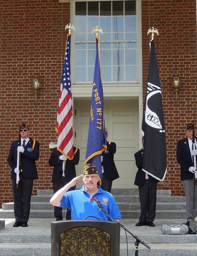 Veteran Mac McCarl salutes at the end of the ceremony.