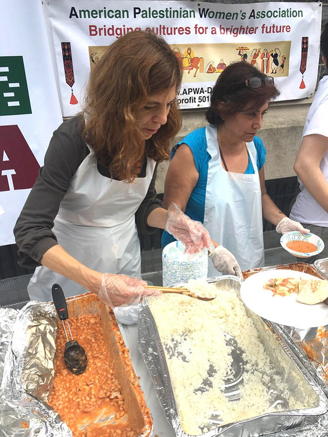 The American Palestinian Women's Association serves the traditional Palestinian iftar dinner to homeless in D.C. outside Catholic Charities in 2016.
