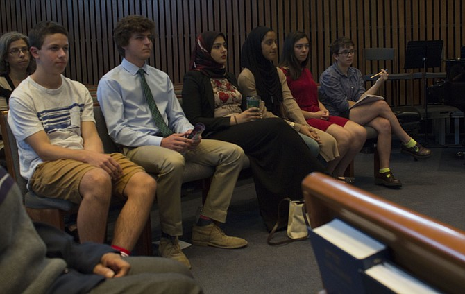 High school students sit in the front row of the Jewish temple and wait to talk to the forum about their experiences with bullying and harassment. From left are Langley High School student Jed Prickett, McLean High School student Jack Reed, J.E.B. Stuart High School students Sara Mohamed and Marafi Badr and McLean High School students Havi Carrillo-Klein and Carmen Beadie.