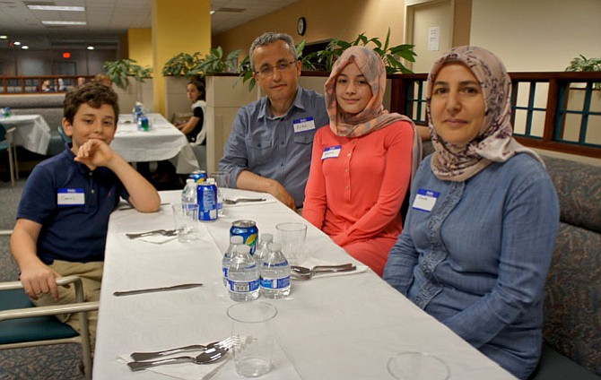 The Kilic family of Vienna, from left, Cemal, Erdal, Yasemine and Emine, at the American Turkish Friendship Association Ramadan Iftar dinner at the Government Center.