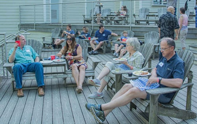 People dine on the deck at the park's visitors' center.