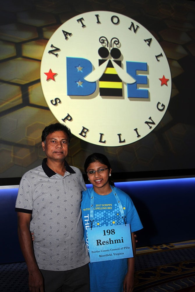 Reshmi Balakrishnan and her dad, Balakrishnan Rengasamy, pose for a picture.