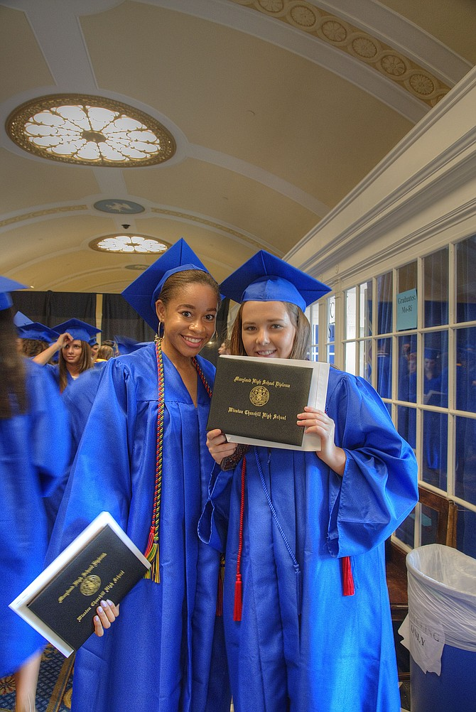 Taegan Myers and Lydia Peabody hold their diplomas after Churchill High School's graduation on Tuesday, May 30 at DAR Constitution Hall.