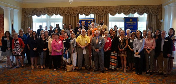 Representatives from 46 social service and nonprofit organizations gather for a group photo after receiving grants totaling $108,000 from the Rotary Club of Alexandria June 6 at Belle Haven Country Club.