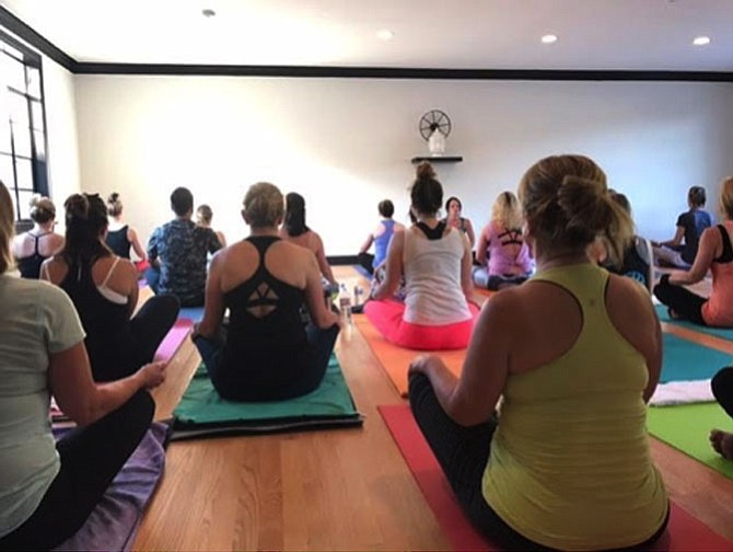 Following the ribbon-cutting ceremony for the new space, Pollard and Layfield held a free Vinyasa yoga class to celebrate the opening of the new studio.