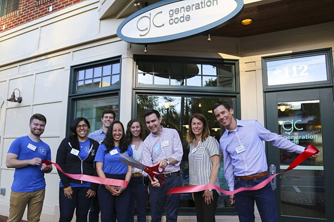 Generation Code staff gather around CEO Terry McDonough, Mayor Laurie DiRocco and Strayer Education CFO and Vienna local, Dan Jackson, to celebrate the opening the new Vienna coding lab.