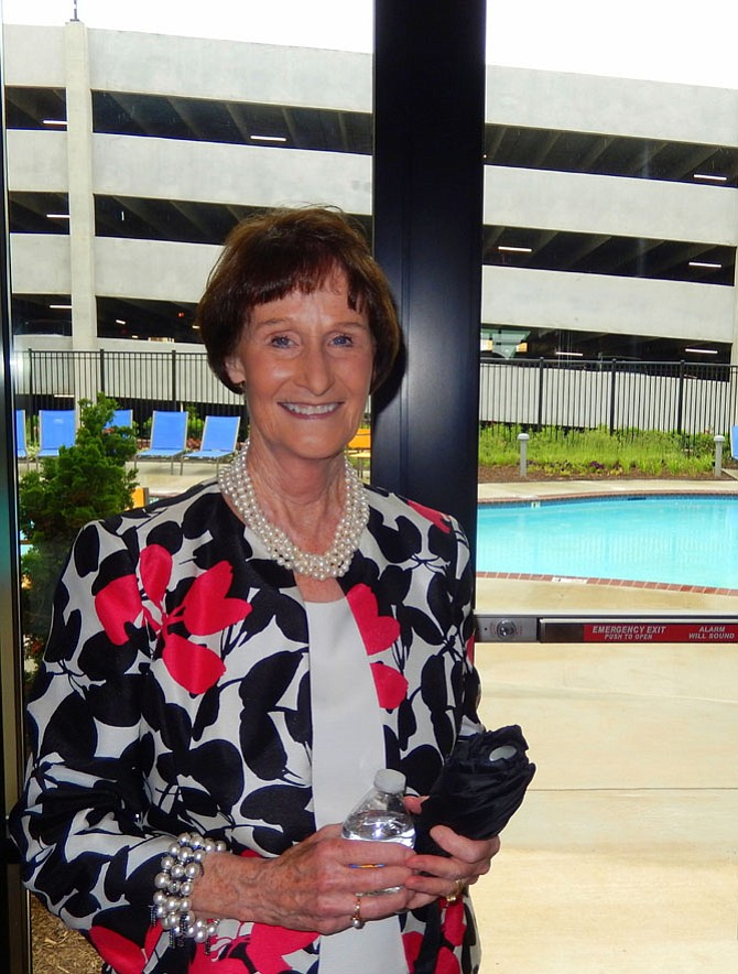 With the pool in the background, Sharon Bulova stands in the building's club room.