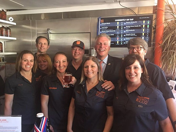 Virginia Gov. Terry McAuliffe toured the Lake Anne Brew House on Friday, June 9, and staff taught him how to pour his own beer from the tap.