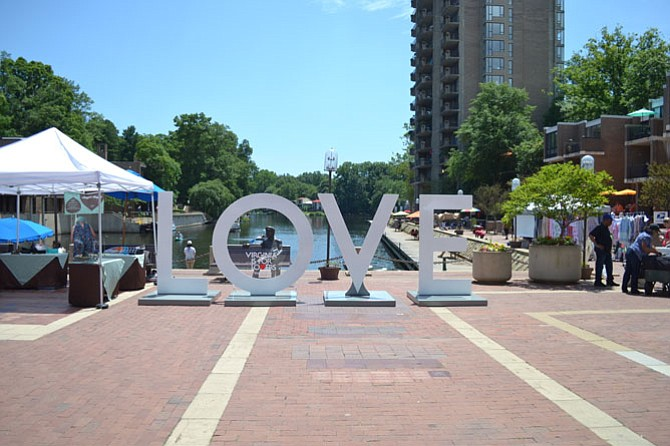 The Virginia is for Lovers 'Love Sign' currently rests at Lake Anne, where residents can visit and pose with the famous sign.