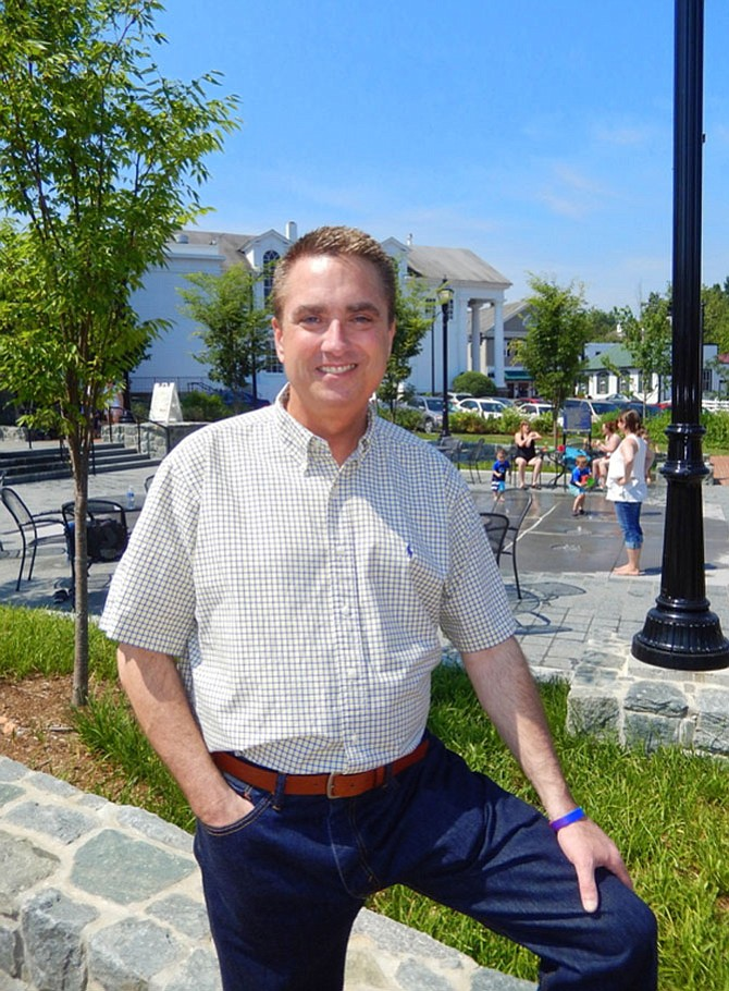 Former Fairfax City Mayor Scott Silverthorne enjoying Old Town Square, which was approved and built during his tenure.