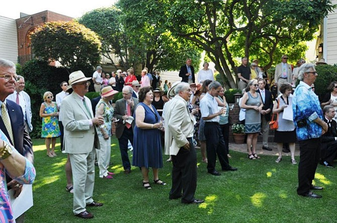 Supporters of the Historic Alexandria Foundation gather for its annual Garden Party on Sunday afternoon, June 11.
