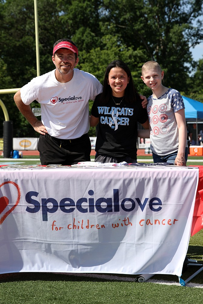 The Festival to Fight Cancer was held on June 10, at Centreville High School. Valerie Nguyen (center), founder of the Wildcats vs. Cancer Club, stands with Dave Smith from Special Love and Tatum Foster, a childhood cancer patient currently battling Ewing's Sarcoma while searching for a bone marrow match.