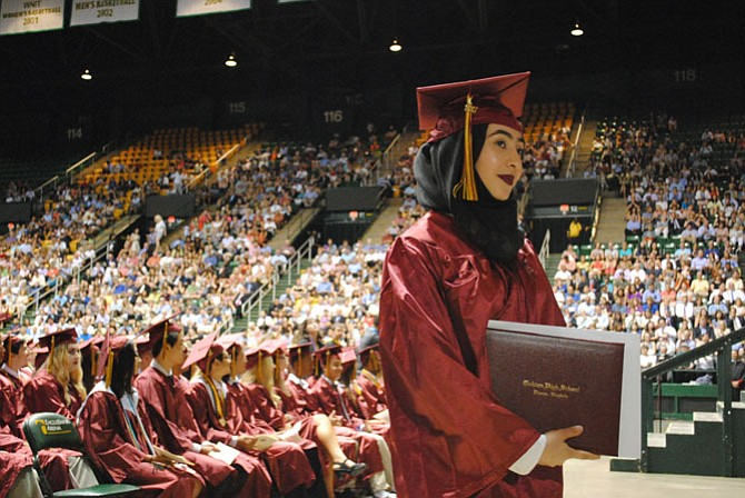 Students received their diplomas and stopped to have their pictures taken once they stepped off the stage.