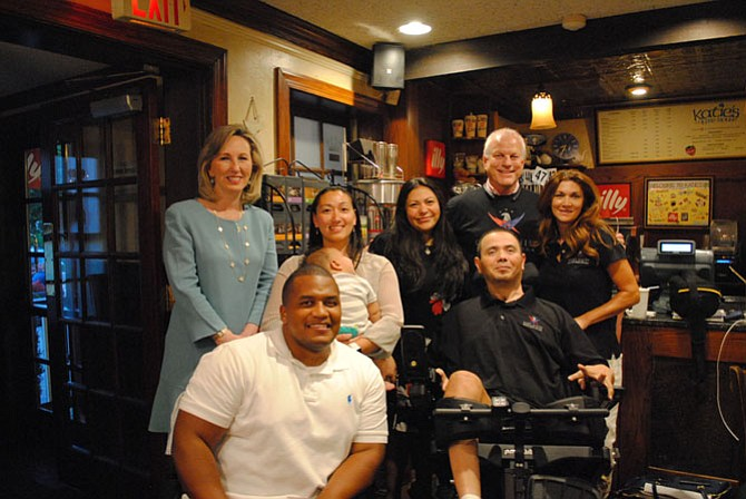 U.S. Rep. Barbara Comstock (R-10) came to support the families helped by the Gary Sinise Foundation. From left: Comstock, Capt. Jeremy Haynes, Chelsea Haynes holding their child Joseph, Claudia Avila, Luis Avila, Bob Nelson and Linda Lowry.