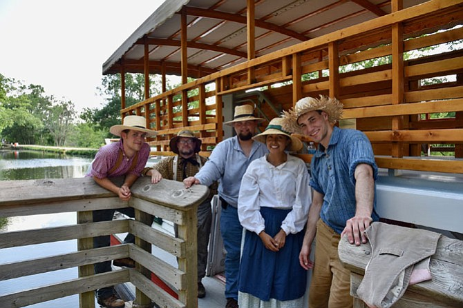 Park Rangers Joshua Nolen, Geoff Suiter, Alex  Arnold, Patricia Miguel, and Michael Ehrenberg work on the canal boat at the C&O National Historic Park. The boat runs Fridays, Saturdays, and Sundays at 11 a.m., 1:30 p.m., and 3 p.m. through Labor Day.