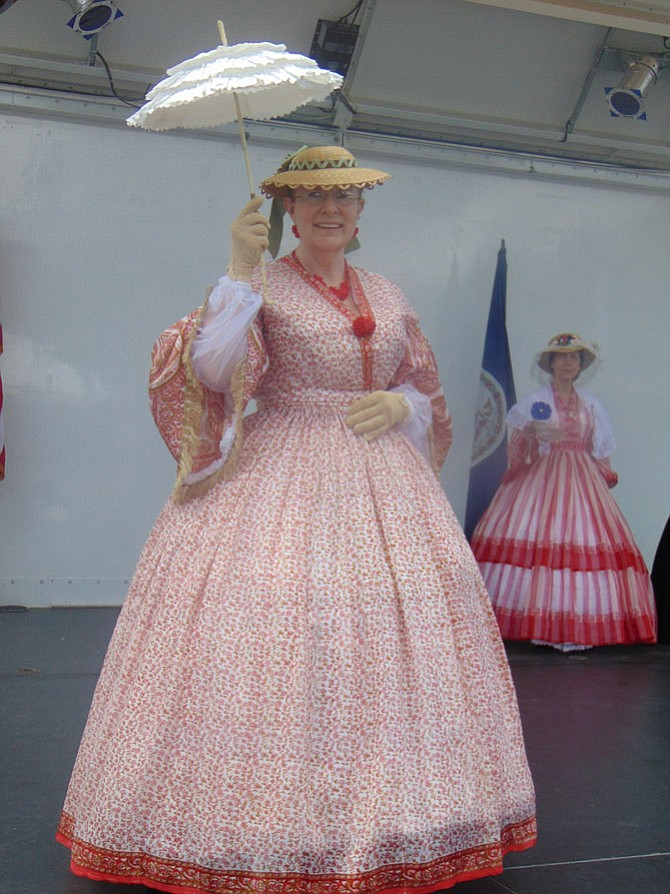 Darline DeMott models a 19th century costume of an upper class lady at the Fairfax Fashion Through the Years: The 18th, 19th & Early 20th Centuries fashion show at Fairfax County's 275th Anniversary celebration on Saturday, June 17, 2017, in the City of Fairfax.