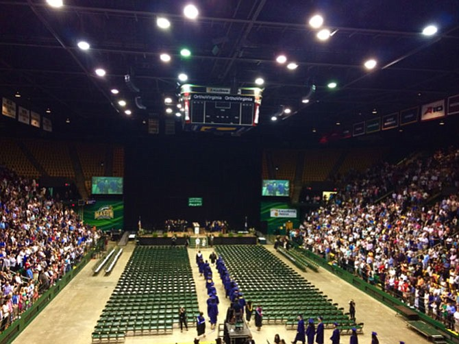 South County High School graduates enter the George Mason University's Eagle Bank Arena on June 16.