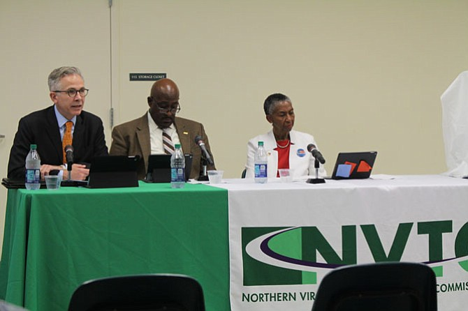 Members of the Washington Metropolitan Area Transit Authority board, from left, Paul C. Smedberg, Christian Dorsey, Catherine Hudgins listen to residents at the Durant Art Center on June 15.