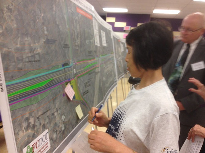 Haiping Luo points out her bus concern on the project boards.