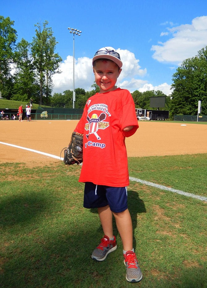 Jack Finney on the field before the Wounded Warrior Amputee Softball Game.