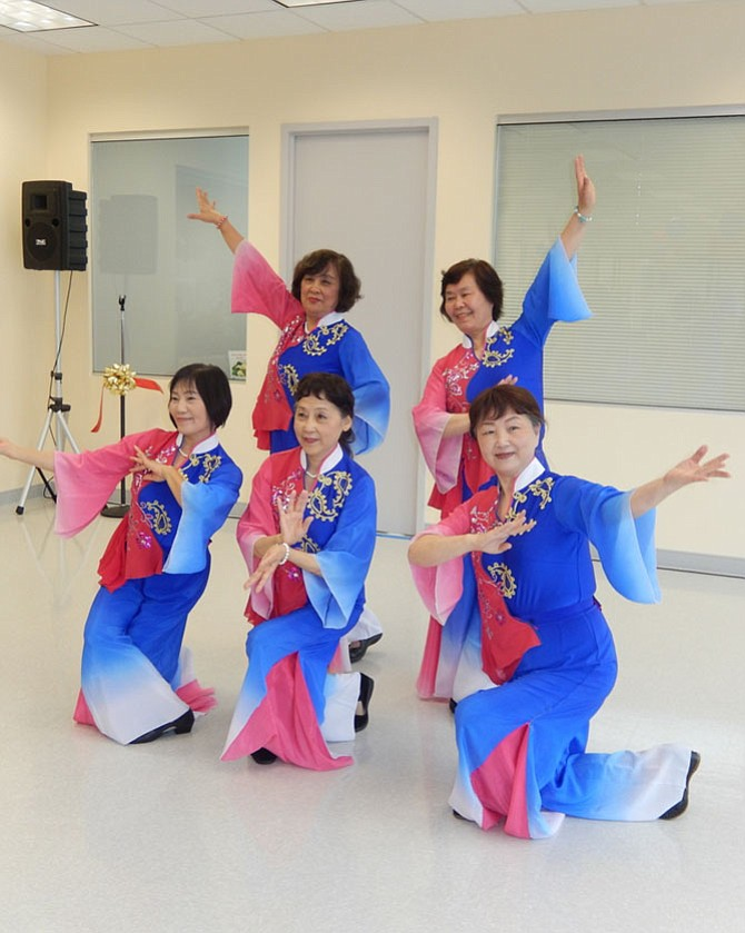 Sully Senior Center dancers entertain during the grand opening ceremony.