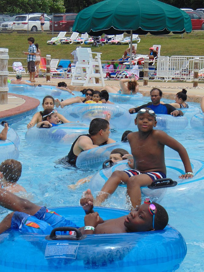 Swimmers enjoy the Rattlesnake River, a 725-foot lazy river, at the Water Mine at Lake Fairfax in Reston on Saturday, July 1.