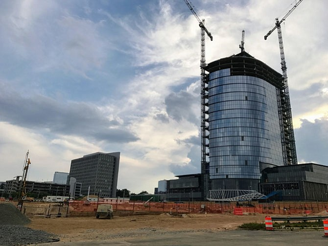 "The Planning Commission recommends allowing Capital One to increase development in Tysons from 4.9 million square feet to 5.2 million square feet, while offering a ""world class performing arts center"" in place of a previously approved community center. The Board of Supervisors will decide on July 11."
