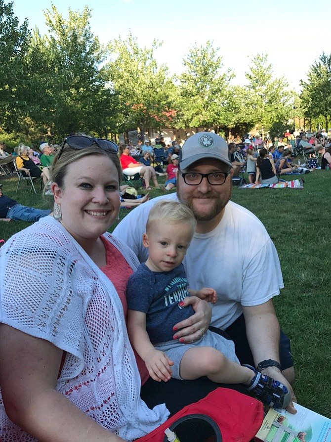 """From left, Lisa Davis, CJ Davis, 2, and Colin Davis. """"In comparison to Wolf Trap, it's easy getting in and out. And it's free,"""" said Lisa Davis of Reston."""