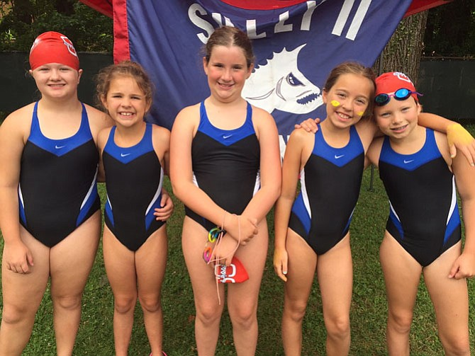 Sully Station II Piranhas were strong and smiling throughout the day. From left are 9-10 girls Ella Ammons, Ehma Stalfort, Suzanna Walser, Alyssa Norris, Lilly Wilson