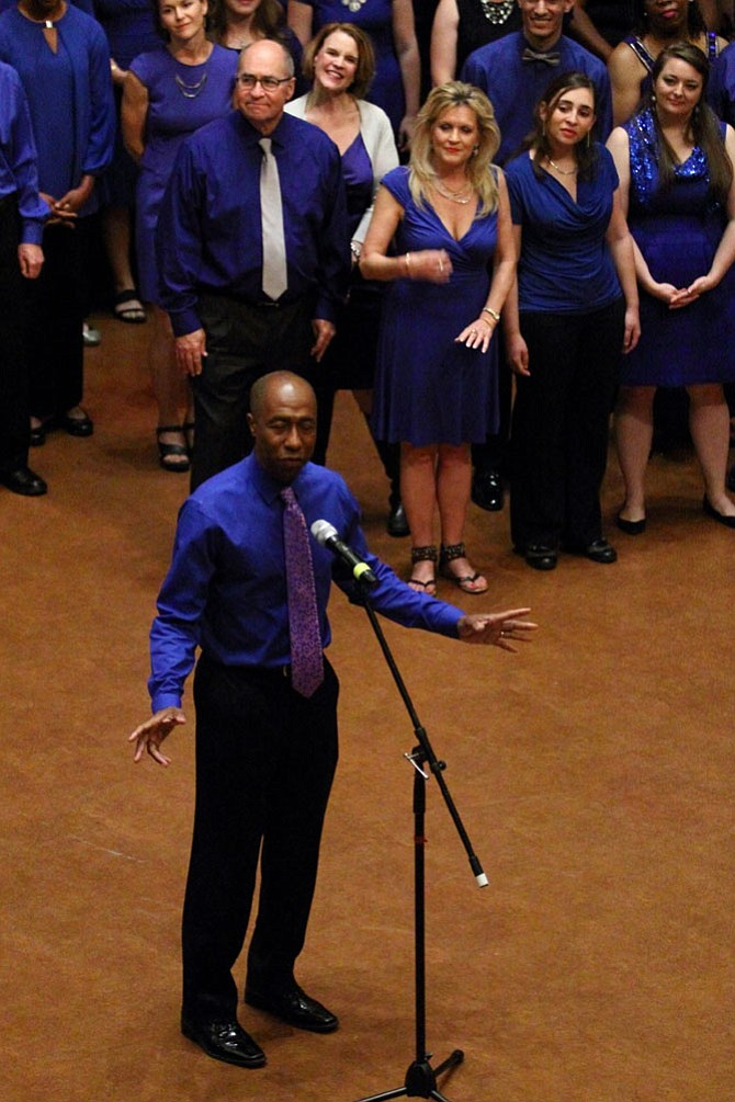 "Jesse Dingle, outgoing principal of T.C. Williams High School, performs ""Let It Sing"" with the Alexandria Singers June 11 at the George Washington Masonic Memorial. An accomplished singer, Dingle has been a tenor soloist with the group for the last two years."