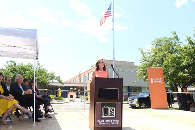 Dorothy McAuliffe speaks about the free summer meals program at Mount Vernon Woods Elementary School on June 28.