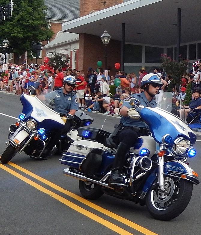 Fairfax City police maneuver their motorcycles.