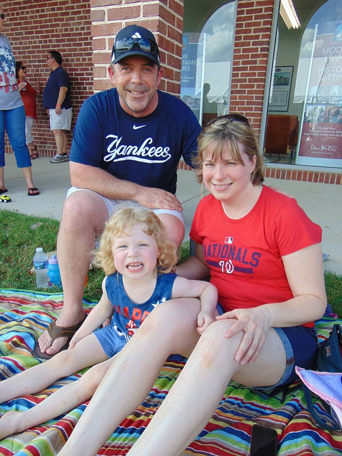 Tim, Betsy and Natalie Moore of Burke wait for the fireworks celebration at the Workhouse Arts Center in Lorton on Saturday July 1.