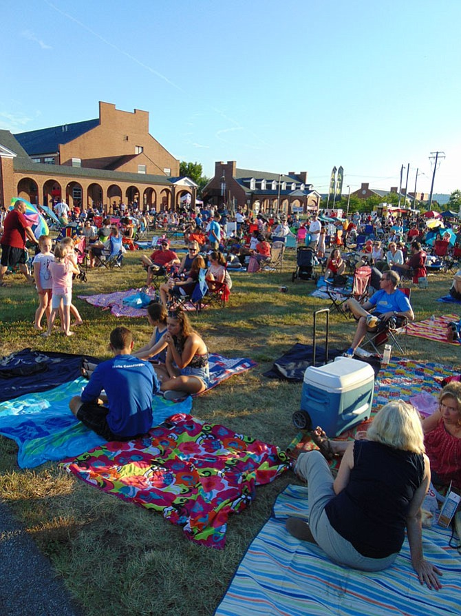 The campus green of the Workhouse Arts Center in Lorton was packed with families setting up their blankets and lawn chairs before the fireworks began on Saturday, July 1 for the Independence Day Celebration.