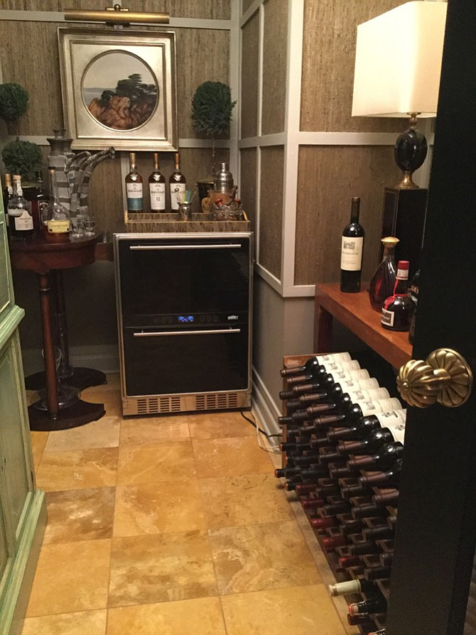 Interior designer Joe Van Goethem transformed a walk-in closet in his McLean home into a wine cellar.