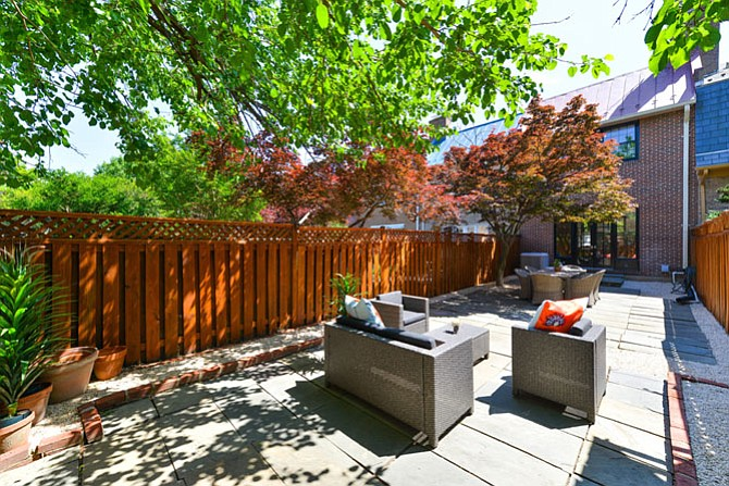 The patio of this Old Town home was designed to be a backyard oasis.