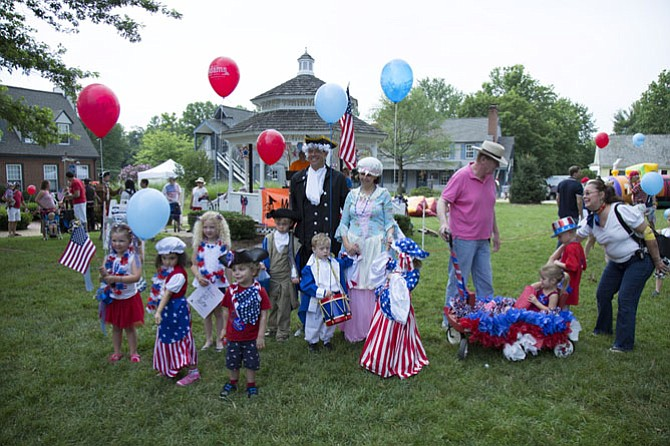 "The foundation for Great Falls Friends and Neighbors sponsored and judged the Little Patriot Parade, which asked babies and toddlers up to 5 years old to show off their finest patriotic attire in a parade that marched around the gazebo on the green of the Great Falls Village Centre. Awards were given for ""Young George Washington,"" ""Little Miss Betsy Ross,"" ""Most Patriotic Baby,"" ""Most Creative,"" ""Most Patriotic,"" ""Best Decorated"" and ""Star Spangled Family."""