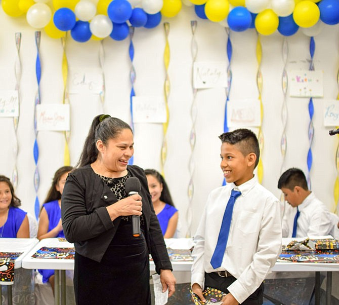 Every year parents of the Chirilagua community pause to come together and celebrate a milestone: their rising 5th grade children's graduation from Kids Club.