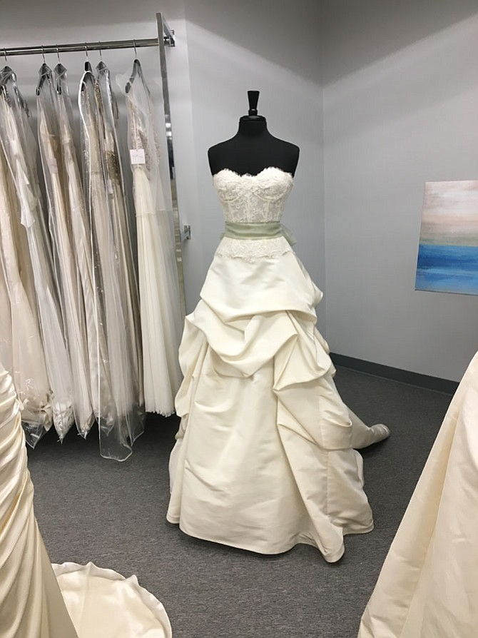 Say Yes for Less opened recently in Cabin John Mall. Owner Pamela Vito sells designer wedding dress samples to allow brides to pay less and still look great on their wedding day.