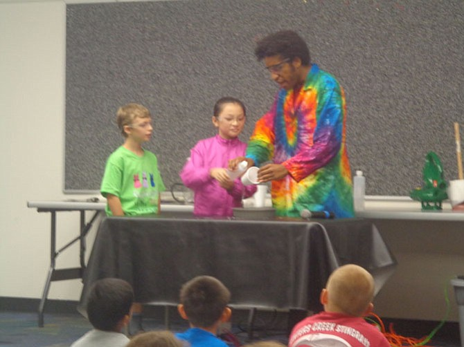 "Children assist Devin Johnson during  the ""Tall Ships and Pirate Tails"" performance at Reston Regional Library on July 6."