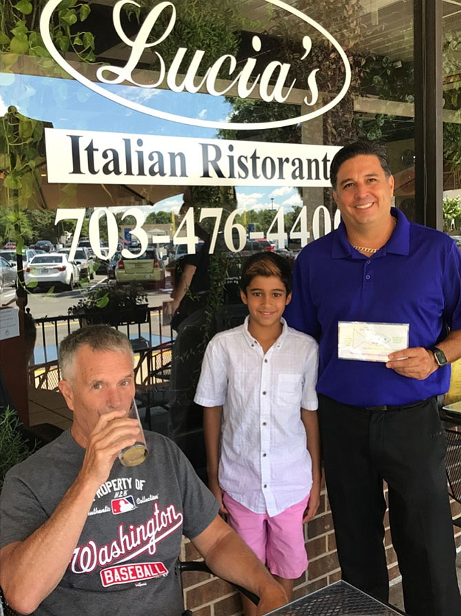 Karan Marari, 11, has his eye on being a marine environmentalist. In the meantime, his goal is to educate and work with local restaurant owners, such as Barrie Impellizzeri, co-owner of Lucia's Italiano Ristorante in Herndon by sharing information with them about the adverse impact plastic straws have on marine life. Jim Powers, a restaurant patron, sips his drink without a straw.