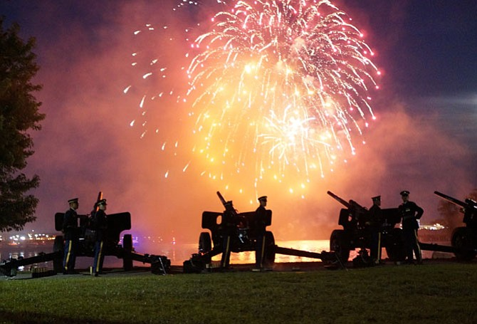 "Cannon fire from the Presidential Salute Battery of the 3rd United States Infantry Regiment at Joint Base Myer-Henderson Hall highlights the grand finale fireworks display during Tchaikovsky's ""1812 Overture"" at the City of Alexandria's 268th birthday celebration July 8 at Oronoco Bay Park."