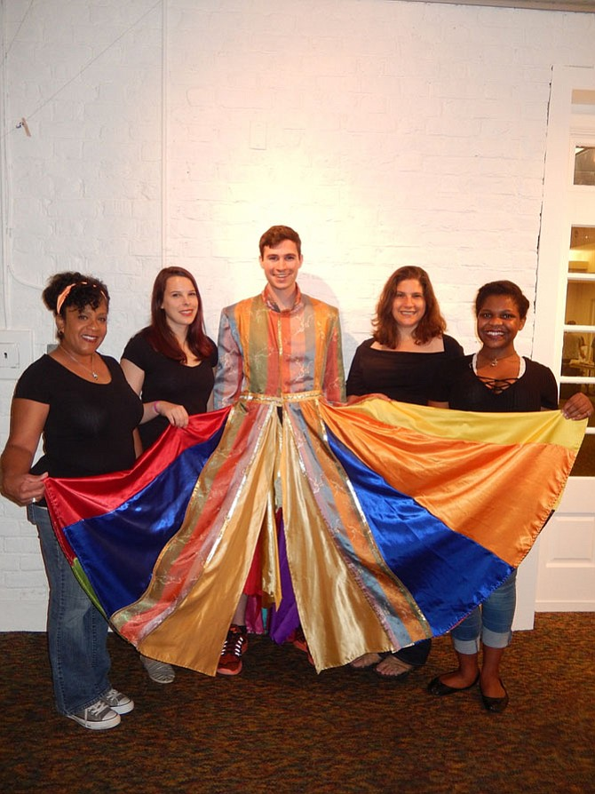"""Wearing the musical's iconic coat, Elijah King poses with """"Joseph and the Amazing Technicolor Dreamcoat's"""" narrators (from left) Bruni Herring, Peyton Avery, Allyson Jacob and Tatiane Jones."""