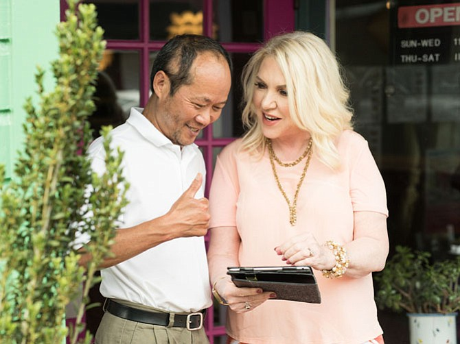 Campaigning for City Council, Karen Habitzreuther chats with Dong Dang, owner of Eastwind restaurant in Old Town Fairfax.