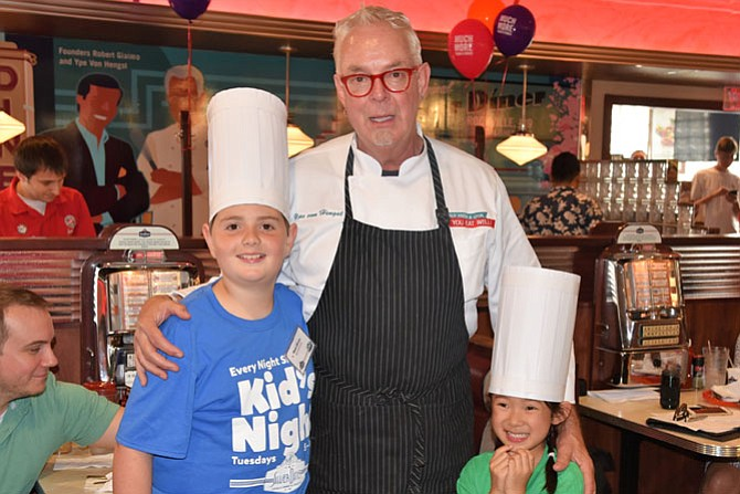 Noelle Sarntinoranont, 6, from Fairfax, on right, is standing with Silver Diner's Chef Ype Von Hengst, executive chef and co-founder of Silver Diner, and co-winner Noah Knapp, 10, from Washington, D.C. Both youngsters were selected as the two top winners of the Silver Diner's recent Kids' Tasting and Recipe Competition. They received Silver Diner Kids Meals for a year and a $500 Silver Diner gift card for their family members.