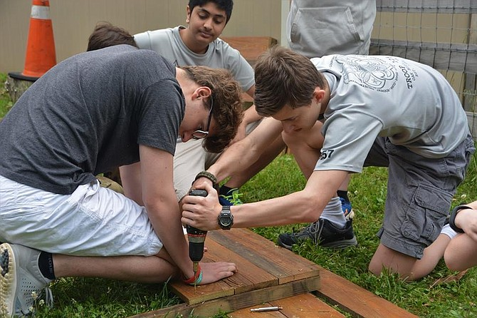 Scouts with the Boy Scouts of America Troop 1257 of Oakton helped Alexander Yusman, 13, of Herndon finish his service project — planting herb gardens — at the Fairfax County Animal Shelter on Sunday, May 21.